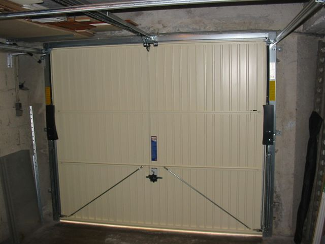 Installation thermique porte garage basculante sur mesure for Porte translation